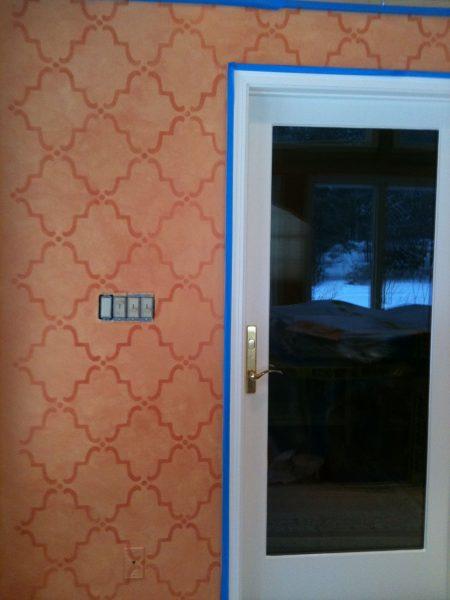 Stencil completed left of door
